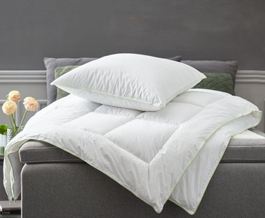King size duvet with natural filling from JYSK in grey bedroom