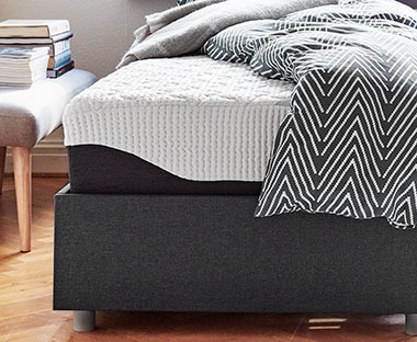 A luxury memory foam mattress with aztec print bedding