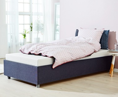 A memory foam mattress single bed with pink bedding