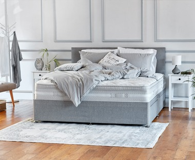 Deep quality cushion top mattress with bonell springs. Padded with pressure-relieving memory foam and high resilience foam.