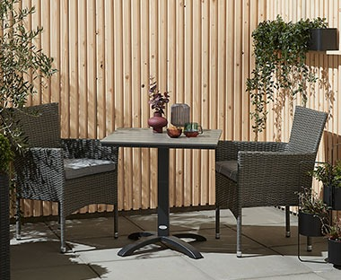 Artwood square bistro table in black with two black polyrattan garden chairs