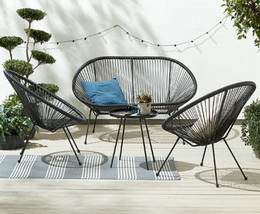 Black string garden furniture chairs and sofa