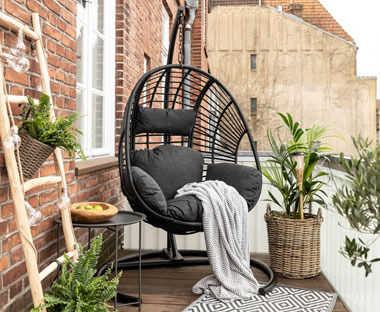Black hanging garden chair on balcony