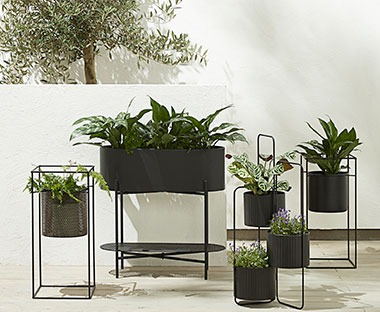 black garden planters made from metal ranging in tall planters and short planters