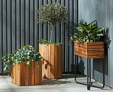Wood plank planters. Square box planters and tall cylinder planters