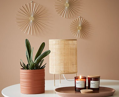Terracotta vase and burnt orange tinted glass scented candles