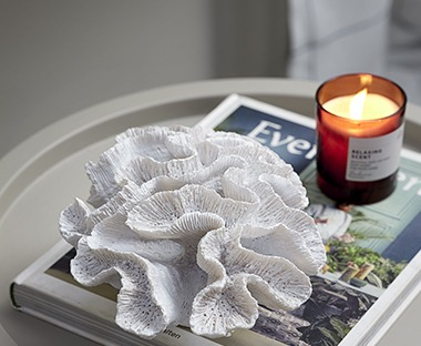 white ceramic coral ornament with glass scented candle
