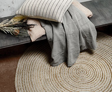 Circular rug made from jute in earthy colours