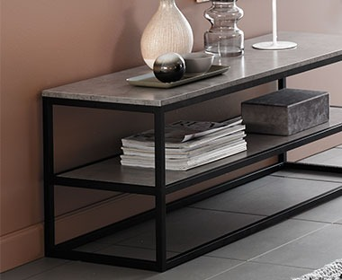 Sleek modern tv stand with concrete look top and metal frame with shelf