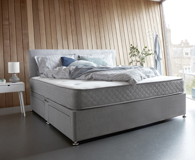A double spring mattress in a contemporary room set up