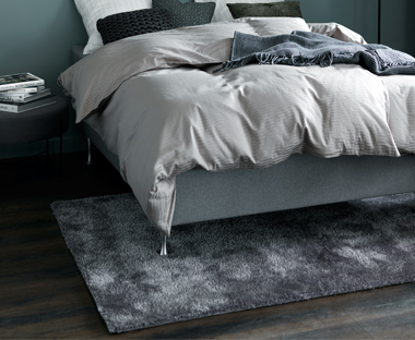 A large grey plush rug