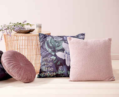 Pink and cream cushions give a soft expression to your home