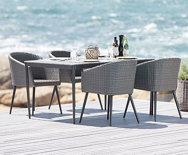 rattan garden dining and lounge chairs in grey