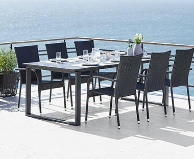 large dining table and chairs in black for patio and outdoor space