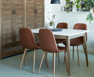 Transform your dining space with faux leather chairs