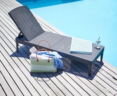 black sunlounger and sunbed