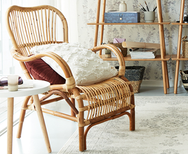 Introduce something different to your living room like a wicker armchair