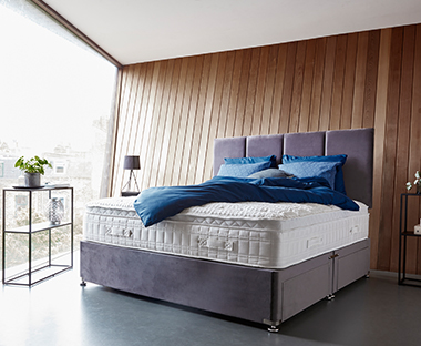 ccbab26f8b55e bedroom furniture and mattresses. A grey material bed frame with ...