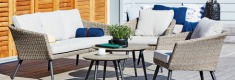 Rattan garden furniture lounge set on patio area