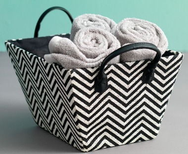 Material storage basket and grey towels