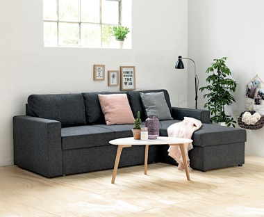 Dark grey fabric sofa bed with storage compartment