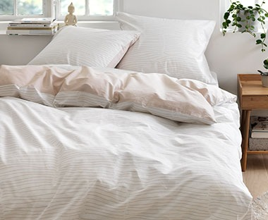 A beautiful striped print duvet cover in dusky pink and cream tones