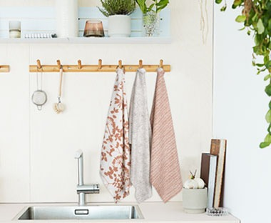 muted pink tea towels with various patterns