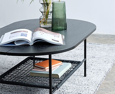 Black wooden coffee table with magazine rack