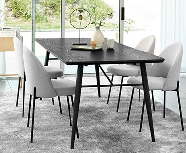Dark dining table black with grey upholstered chairs