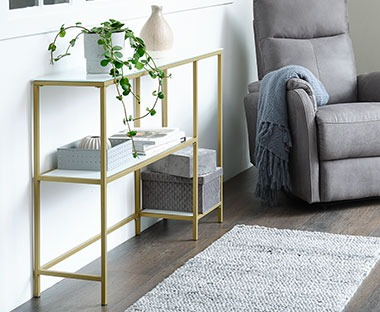 tempered glass console table with gold metal detailing