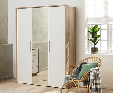 A white and oak wardrobe three door with mirror