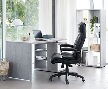 Concrete look office desk with cupboard and shelves