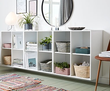 white shelving unit with four shelves