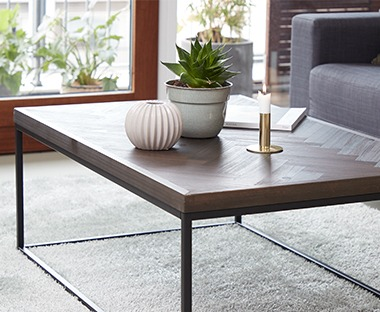 Solid wood patterned table with metal legs.