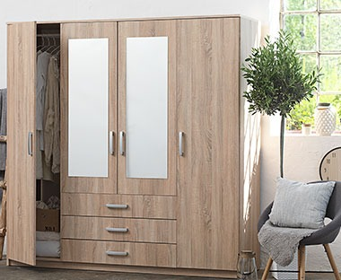 Solid oak wood four door wardrobe with mirror