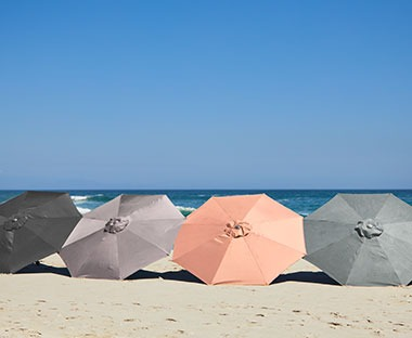 parasols on a beach in assorted colours