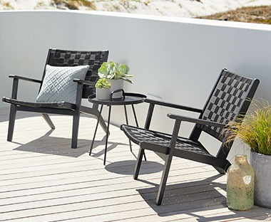 low garden lounge chairs in black for relaxing in the sunshine