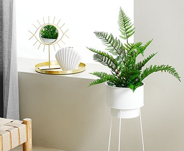 A faux fern plant for indoor home decoration