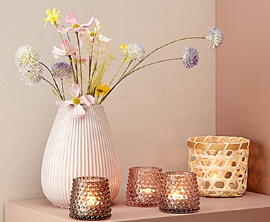 pink and peach toned glass tealight holders with embossed glass