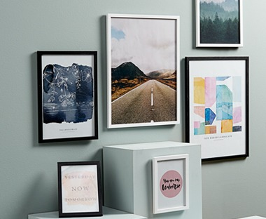 Photo frames in assorted colours and sizes black white and oak