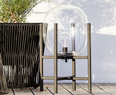 An outdoor lamp with steel frame and glass cover