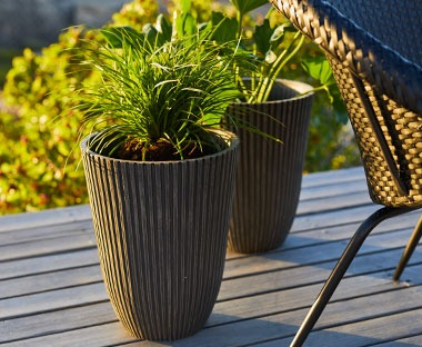 large black planter for tall plants for your outdoor space