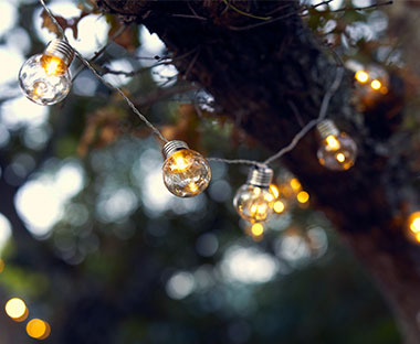garden string lights to create a cosy atmosphere in summer evenings