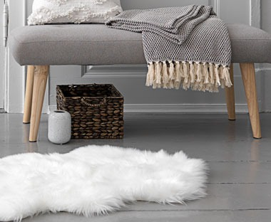 A faux fur rug in white
