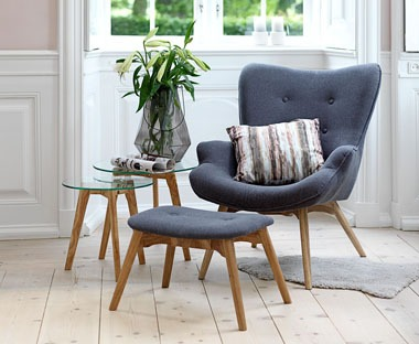 Grey wingback armchair with footstool.