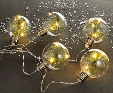 globe string lights with christmas pine inside
