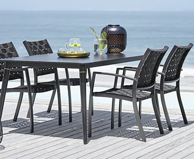 hand woven garden chair with garden dining table in black
