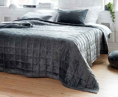 A luxurious bed throw in grey