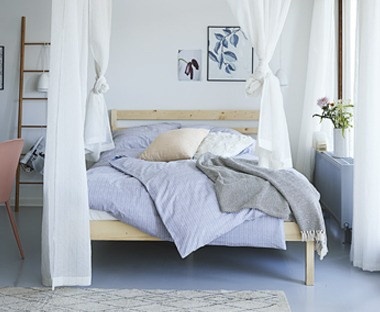 Minimalist bedroom look double bed with blue bedding