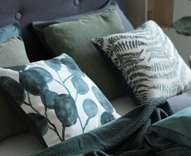 Scatter cushions with printed designs in white and teal